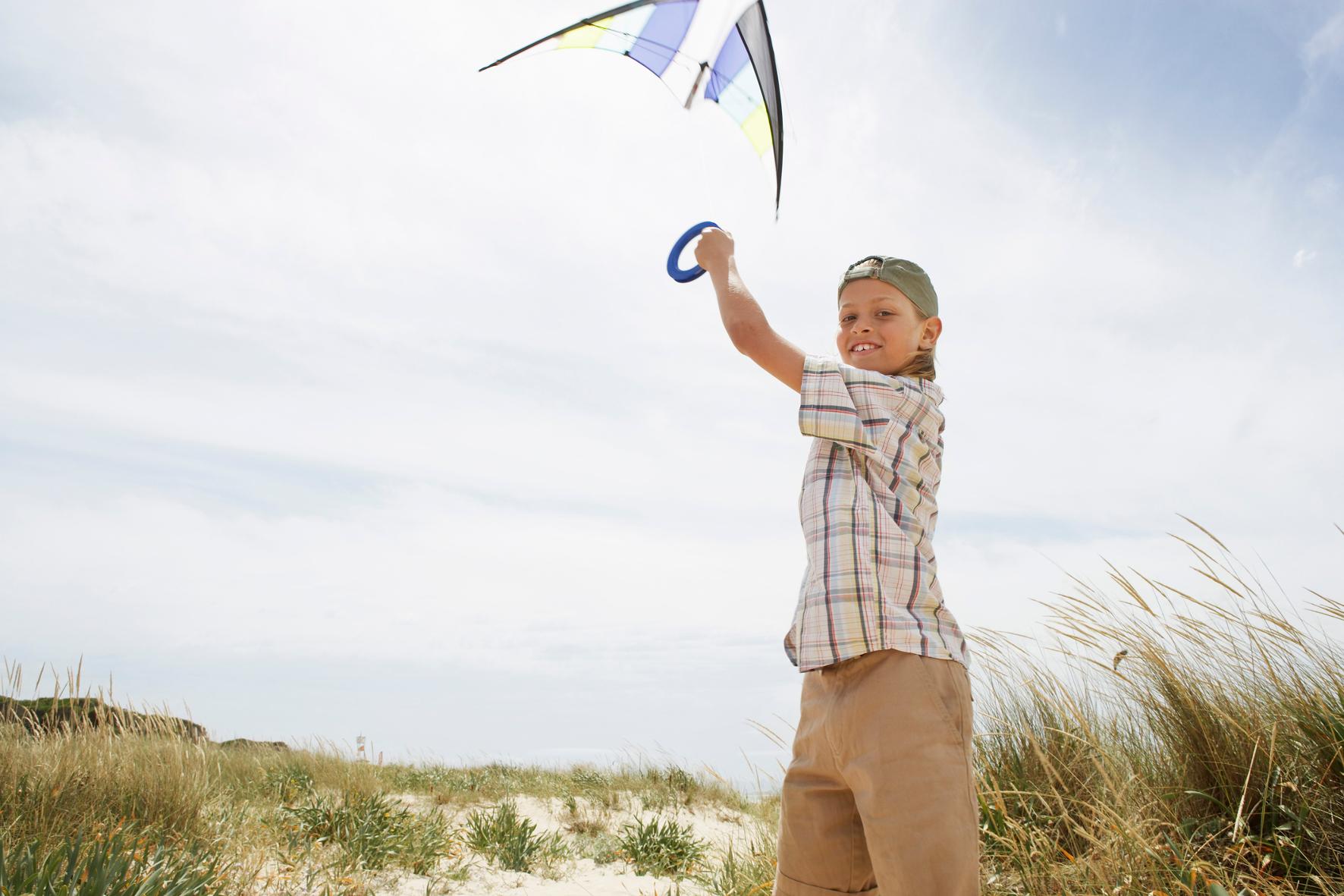Girl Flying Kite at Sand Dunes